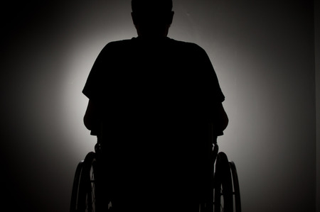 25931241 - sad man sitting on wheelchair in empty room