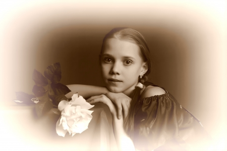 9081330 - thoughtful girl with a white rose